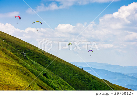 Skydiving extreme over the mountains 29760127
