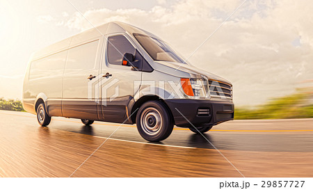 Gray Commercial Van on Countryside Road in Motion 29857727