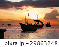 Silhouettes of anchored fishing boats 29863248