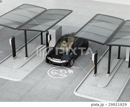 公共施設の充電スタンドに充電している黒色の電気自動車 29921929