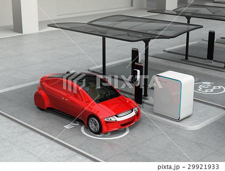 公共施設の充電スタンドに充電している赤色の電気自動車 29921933