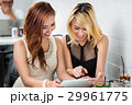 Two stylish young women surfing the net 29961775