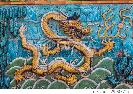 Golden dragon with white crest floating in waves 29987717