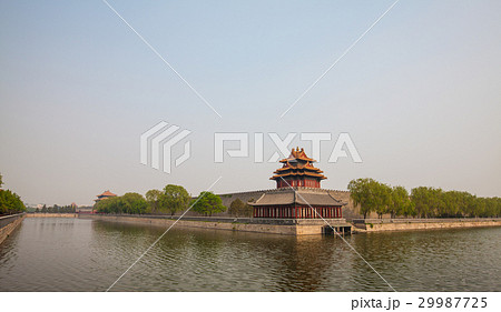 Tower surrounded by moat with water in Beijing 29987725