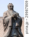 Bronze statue of Confucius in traditional pose 29987809