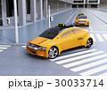 交差点に右折する黄色いタクシーのイメージ 30033714