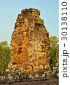 Giant stone faces at Bayon Temple in Cambodia 30138110