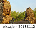 Giant stone faces at Bayon Temple in Cambodia 30138112