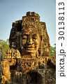 Giant stone faces at Bayon Temple in Cambodia 30138113