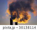 emissions from plant pipe against setting sun 30138114