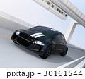 高速道路に走行している黒いスポーツカー。背景に懸垂式モノレールが運行している。 30161544