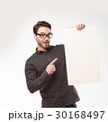 Young happy man showing presentation, pointing on 30168497