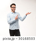 Young happy man showing presentation, pointing on 30168503