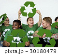 People in group wearing recycle icon shirts and posing for photoshoot 30180479
