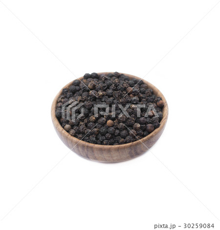 Black pepper in wooden bowl isolated on whiteの写真素材 [30259084] - PIXTA