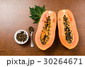 Ripe papaya fruit on wooden background 30264671