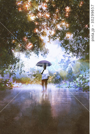 man holds umbrella standing on the wet road 30299657