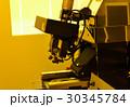 microscope in laboratory under the yellow light  30345784