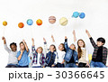 Group of Kids Holding Papercraft Galaxy Symbol on White Blackground 30366645