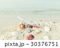Bottle with a message or letter on the beach 30376751