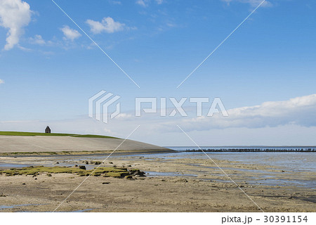 Mud-flats and Dike of Waddensea and Church 30391154