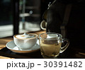 A cup of coffee and a cup of tea on the wood table 30391482