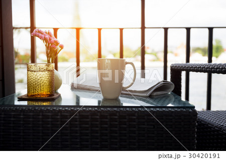 Cup of coffee with glass water and newspaper の写真素材 [30420191] - PIXTA