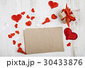 Paper, gift and hearts on a wooden background. 30433876
