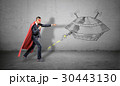 A businessman in a red superhero cape throwing 30443130