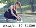 Woman tying shoe laces. Female sport fitness. 30461609