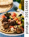 Greek meatballs (keftedes) with pita bread. 30514604