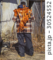 bright orange rope on a person back 30524552