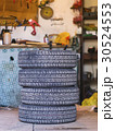 four old tires in a garage 30524553