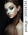 Fashion model Woman with fantasy make up. Long 30534745