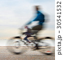 Cycling on embankment 30541532