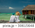 Couple on a beach jetty at Maldives 30615648