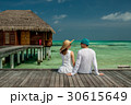 Couple on a beach jetty at Maldives 30615649