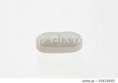 白い楕円形の薬 30628685