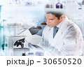 Life scientist researching in the laboratory. 30650520