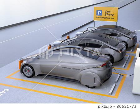 カーシェア専用駐車場に駐車している無人運転電気自動車。カーシェアリングのコンセプト 30651773