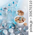 medical drugs and syringe closeup 30670310