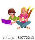 Two girls siting crossed legs, reading book, using 30772213