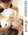 A woman is massaged forehead in spa. 30800284