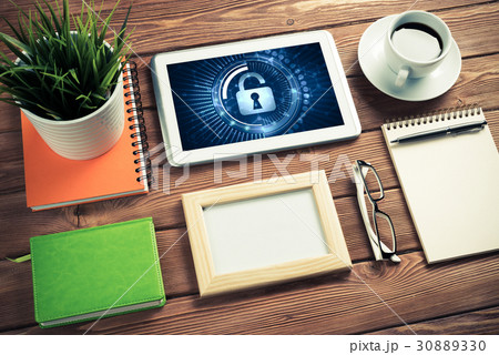 Web security and technology concept with tablet pc on wooden tableの写真素材 [30889330] - PIXTA