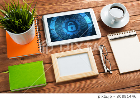 Web security and technology concept with tablet pc on wooden tableの写真素材 [30891446] - PIXTA