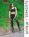 Sports girl in the park on roller skates 30945970