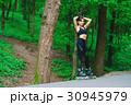 Sports girl in the park on roller skates 30945979
