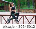 Sports girl in the park on roller skates 30946012