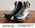 men's army boots on wooden table 30963977