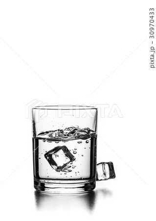 Cube of ice thrown into a glass with liquidの写真素材 [30970433] - PIXTA